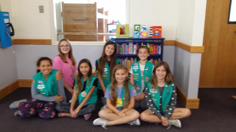 Girl Scouts of Troop 2208 who built a bookshelf, provided baby & toddler books